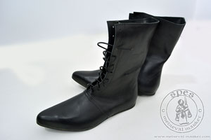 High lace-up medieval boots with a shiny sole - stock. Medieval Market, High lace-up medieval boots with a shiny sole - stock